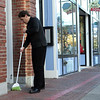 Salem: Murray Lee of Next Exec., Inc. sweeps in the sidewalk in front of his business. Business is back to usual as the Halloween season is over. Photo by Mark Lorenz/Salem News