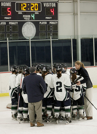 Hamilton: Pingree's head coach Sarah Carpenter talks with her players after fallen to Berwick in the  EIL Hockey Finals,  5-4 in sudden death overtime. Photo by Mark Lorenz/Salem News
