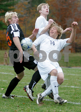 Hamilton: Hamilton-Wenham High School's #14 Zach Gaucher gets tangled with Ipsiwch High's Anthony Longo and teammate, Tad Dectaur in first quarter of play. Photo by Mark Lorenz/Salem News