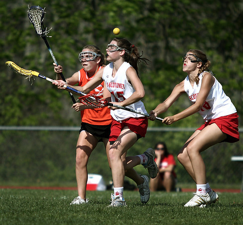 Middleton: Ipswich High Grace Gardner looks for the ball against Mascos Mary Guinee and Becca Philips in lacrosse game. Photo by Mark Lorenz/Salem News