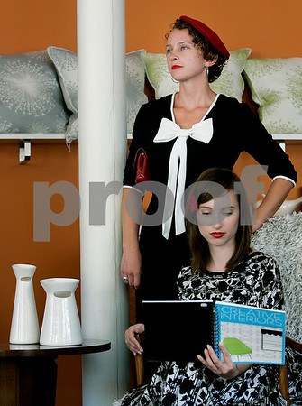 Salem: Lindsay Erben and Rochelle Bourgault, both of Salem, wearing clothing from Modern Millie's fashion of the 60's style clothing at Cabin Fever. Photo by Mark Lorenz/Salem News September 4, 2008