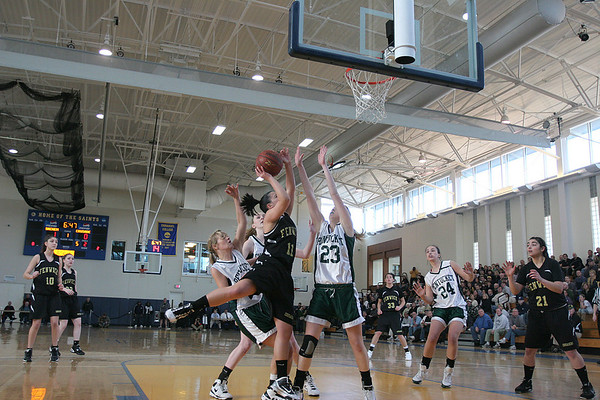 Boston: Bishop Fenwick Amy Pelletier drives to the basket against Pentucket defense in the first quarter, during Division III North Sectional Championship at Emmanual College. Photo by Mark Lorenz/Salem News