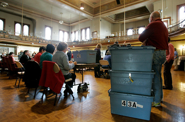 Peabody: John Lincoln stands to ballots boxes from the Ward 4 council race, during a recount at Peabody City Hall, Saturday morning. photo by Mark Lorenz/Salem News