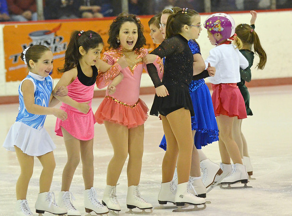 Peabody: Emily McDonough, 7, left, Anood Abuzahra, 7, Amanda Marmiani, 9, and Milena Santos, 7, skate together in formation at the Peabody Skating Club's 36th annual Ice Show. photo by Mark Teiwes