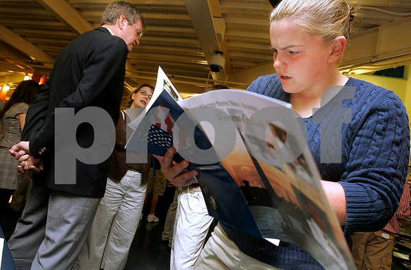 Danvers: Salem High School senior Cara Buckley looks over information from the Naval Academy where she would is planning on going after high school,  during Congressman John Tierney's Service Academies Night, held at North Shore Community College. Photo by Mark Lorenz/Salem News