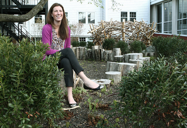 Beverly: Kelly Sheehan, Shore County Day School alumni, sits in the Inspiration Garden, which also serves as an outdoor classroom. The garden commemorate all the alumni who have died before the age of 30, about 6 people. Kelly started the garden who's friend Allison died during a study abroad. Photo by Mark Lorenz/Salem News