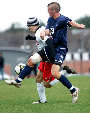 Topsfield: Lincoln-Sudbury High Schools Cole DeNormandie gets tangled with Masco's Stephen Kracunas in Division 1 North quarterfinal. Staff by/Mark Lorenz