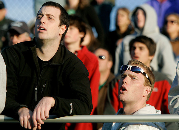 Beverly: Thomas Smith, right, of Swampscott,  a graduate of Pingree School and his friend, Jason Kramer, left watch Pingree School play Brooks School   in the Clark/Francis Bowl as part of NEPSAC playoffs, played at Endicott College. Pingree defeated Brooks 7-6. Staff by/Mark Lorenz