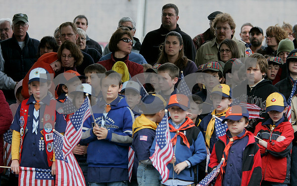 Beverly: Boy Scouts and parents listen as State Rep. Mary Grant speaks during the Beverly Veterans Day serive yesterday morning, held at Odell Park. Staff by/ Mark Lorenz
