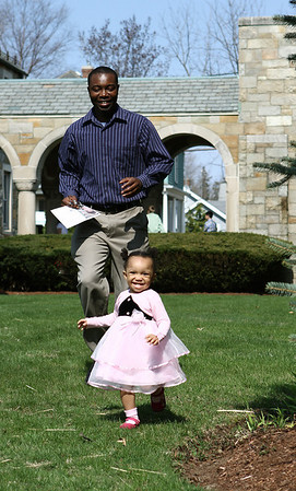 Danvers: Nuku Aggor and his daughter, Elinai of Beverly, enjoy sometime play time after Easter mass at St Mary of The Annunciation Parish. Photo by Mark Lorenz/Salem NewsPhoto by Mark Lorenz/Salem News