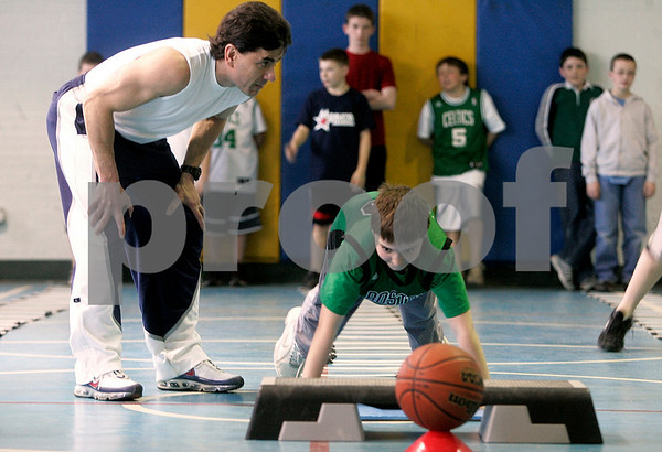 "Middleton: Peter Reppas incourages Renaldo Musto, 11, during work outs at the Howe Manning Elementary School, during a 6 - week class, called "" Athletic Kids. Photo by Mark Lorenz/Salem News"