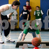 """Middleton: Peter Reppas incourages Renaldo Musto, 11, during work outs at the Howe Manning Elementary School, during a 6 - week class, called """" Athletic Kids. Photo by Mark Lorenz/Salem News"""
