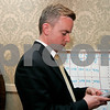 Beverly: John Burke looks over ward numbers at his mayoral party, held att the Franco-American Club. Photo by Mark Lorenz/Salem News