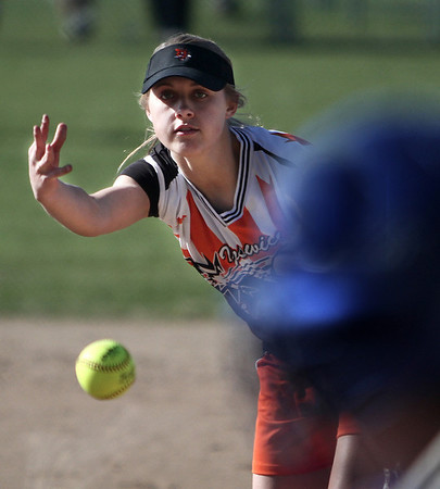 Danvers: Ispwich High School's Katie Glaubitz delivers a pitch to a Danvers High player in game at Great Oak softball fields. photo by Mark Lorenz/Salem News
