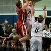 Danvers: Central Catholic's Jimmy Zenevitch gets this shot blocked by St. John's Preps Pat Connaughton late in the game. Photo by Mark Lorenz/Salem News