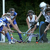 Hamilton: Georgetown High School battle for the ball in front of Hamilton - Wenham's goalie during field hockey. Georgetown eventually scored on the play. Photo by Mark Lorenz/Salem New