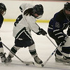 Hamilton: Pingree's Mary Kate Bell is boxed in by Berwick players, Dori Craig and Kaitlyn Wurzer in EIL Hockey Finals. Pingree fell 5-4 in sudden death overtime. Photo by Mark Lorenz/Salem News