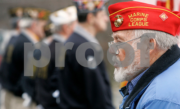 Peabody: Donald Michaud , a former Marine who was in  Iwo Jima, speaks to a small crowd gathered outside of the Kiley School about being on Iwo Jima, over 60 years ago. Photo by Mark Lorenz/Salem News