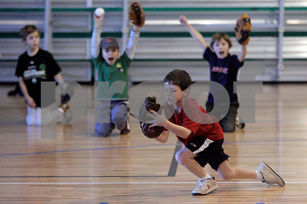 Marblehead: Jackson Klein reacts after catching a baseball during Steve Lomasney baseball clinic at the Marblehead Jewish Community Center. Photo Mark Lorenz/Salem News