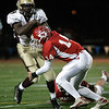 Lowell: Masconomet Regional High School Chris Splinter tackles Concord-Carlisle Jabrail Coy in the third quarter. Photo by Mark Lorenz/Salem News