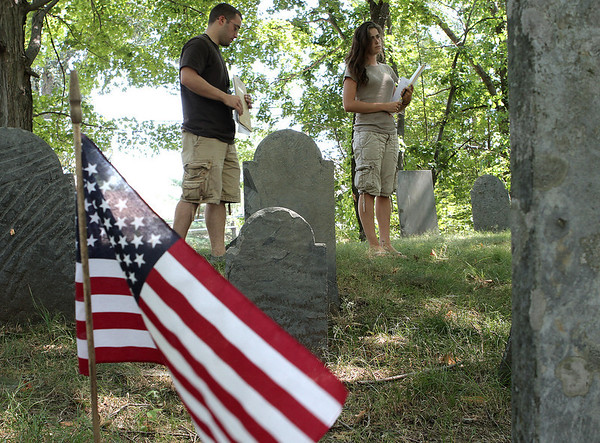 Danvers: Derek McDonald, a St. Anselm graduate, and Masconomet Regional High School senior, Lauren Pitts, look at veterans graves at Preston Street Cemetary. The two along with Danvers High School senior, Chelsea King have been working as interns with the town of Danvers mapping veterans graves around the town. Photo by Mark Lorenz/Salem News<br /> , Danvers: Derek McDonald, a St. Anselm graduate, and Masconomet Regional High School senior, Lauren Pitts, look at veterans graves at Preston Street Cemetary. The two along with Danvers High School senior, Chelsea King have been working as interns with the town of Danvers mapping veterans graves around the town. Photo by Mark Lorenz/Salem News