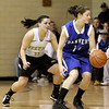 Peabody: Danvers High School basketball player, Sarah Palazola, moves down court as Bishop Fenwick's Amy Pelletier looks to steal the ball. Photo by Mark Lorenz/Salem News
