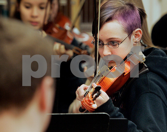 Ipswich: Brianna Hanwell follows closely while orchestra teacher Theresa Natti conducts class, at Ipswich High School during rehearsal. Photo by Mark Lorenz/Salem News