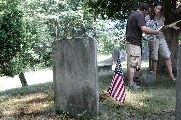 Danvers: Derek McDonald, a St. Anselm graduate, looks over a map of veterans graves Masconomet Regional High School senior, Lauren Pitts, at Preston Street Cemetary. The two along with Danvers High School senior, Chelsea King have been working as interns with the town of Danvers mapping all veterans graves. Photo by Mark Lorenz/Salem News