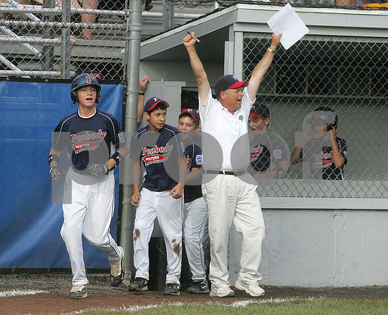 Bristol: Peabody West coach and teammates celebrate after Matt Hosman hit a three run home run, giving them a 3-0 lead over Connecticut in New England Semi-Final game. Photo by Mark Lorenz/Salem News