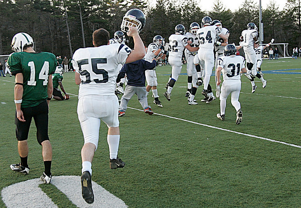 Beverly: Brooks School Jason Buco walks away as Pingree School players celebrate their 7-6 victory. Pingree scored with 40 seconds left in the game in the Clark/Francis Bowl as part of NEPSAC playoffs, played at Endicott College. Pingree defeated Brooks 7-6. Staff by/Mark Lorenz