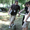 Danvers: St. Anselm graduate, Derek McDonald, looks over veterans grave numbers with Danvers High School senior, Chelsea King, and Masconomet Regional High School senior, Lauren Pitts, at Preston Street Cemetary. The three have been working as interns with the town of Danvers mapping all veterans graves. Many are buried in graveyards that are no longer cared for. Their efforts will provide a map and database for all veterans graves in town. Photo by Mark Lorenz/Salem News