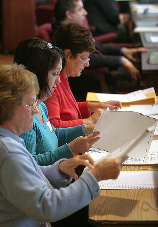 Peabody: Gail Champigny, Patti Schaffer, finance director, and Colleen Kolodziej, assistant city clerk, check ballots before handing them off to be recounted in the Ward 4 council race, at Peabody City Hall, Saturday morning. photo by Mark Lorenz/Salem News