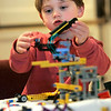 Wenham: Elijah Greenberg, 4, plays with his Legos creation he made at the Lego Maniacs Palooza, held at the Wenham Museum. Elijah enjoyed the event with his mother, Kim Dietel of Hamilton. Photo by Mark Lorenz/Salem News