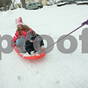 Danvers: Ava Navarro, 6, along with her brother, Tyler, 3, enjoy the snow while being pulled on their sled by their mother, Mandy on Chapel Road. The Northshore was hit by another winter storm. Photo by Mark Lorenz/Salem News