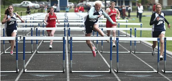 Hamilton: Natalie White takes first in the girls hurdles in meet against Masconomet at Hamilton-Wenham Regional High School. Photo by Mark Lorenz/Salem News