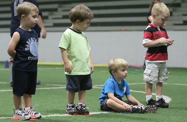 Beverly: Connor DiTomaso of Peabody, Colin Fidler of Salem, Josh Adler of Merrimack, and Kegan Winterton of Danvers prepare to take shots at the goal during soccer for tots, at New England Aztecs Soccer. Photo by Mark Lorenz/Salem News