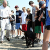 Peabody: Sgt. Stephen Cunningham, Massachusetts State Police fire and explosion investigation section with his arson dog, Yahtzee, demostrates to kids in the Fire Fighters In Training Program and the Peabody Park & Recreation camp, held at Brooksby Farm. The camp was lead by  Joe DeFranco, Peabody Fire Inspector.  Photo by Mark Lorenz/Salem News