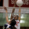 Salem: Salem High School's Stella Gutierrez blocks a shot against Malden's Eva Chan in their first set. Photo by Mark Lorenz/Salem News