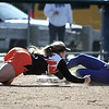 Danvers: Ispwich High School third baseman, Kelly Michael cannot get the tag on Danvers High player, Alicia Dean in game at Great Oak softball fields. photo by Mark Lorenz/Salem News