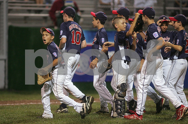 Bristol: Peabody West celebrate after defeating Connecticut 12-1 in New England Semi-Final game. Photo by Mark Lorenz/Salem News