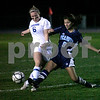 Danvers: Danvers High School's Kathleen Landers battles for ball against Peabody High's Emily Manoogian,  in the first period, at Danvers High School. Photo by Mark Lorenz/Salem News