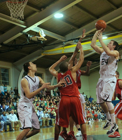 Danvers: St. John's Prep Pat Connaughton makes this shot late in the game, helping to defeat Central Catholic 72-70 . Photo by Mark Lorenz/Salem News
