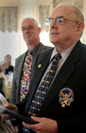 Salem: Roger Whear of Salem, a Korean War Veteran receives the Paul Harris Fellow, Rotary's top award. Next to him is his son, Bruce. Photo by Mark Lorenz/Salem News