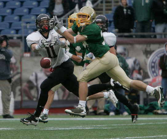 Foxboro: Marblehead Highs Matt Perlow cannot hang onto the ball against Bishop Feehan Kyle Cataldo in the first half of play in Div III Superbowl at Gillette Stadium. Photo by Mark Lorenz/Salem News