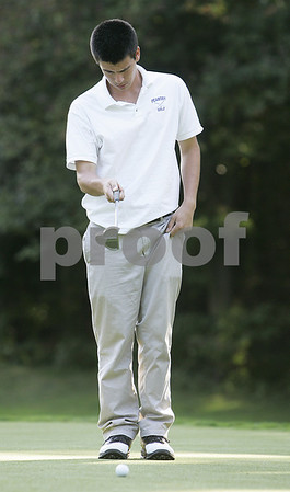 Salem: Peabody High School's Pat Dumas aligns his putt at Salem Country Club in match against Marblehead High School. Photo by Mark Lorenz/Salem News Wednesday, September 24, 2008