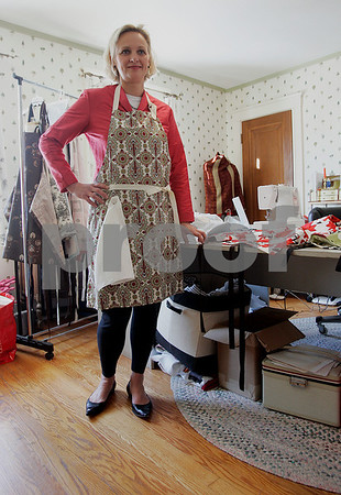 Swampscott: Lynne Rutkowski, with one of her favorite aprons, that she makes and sells through out the U.S and Canada. Photo by Mark Lorenz/Salem News