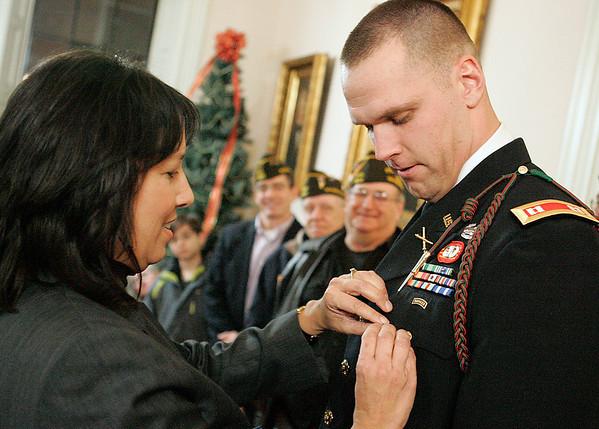 Salem: U.S. Army Captain Peter Harrington of Salem, receives the Salem Veterans Award from Salem Mayor Kim Driscoll at city hall. Photo by Mark Lorenz/Salem News