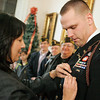 Salem: U.S. Army Captain Peter Harrington of Salem, receives the Salem Veterans Award from Salem Mayor Kim Driscoll at city hall. Photo by Mark Lorenz/Salem News