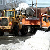 Salem: A bucket loader fills a city truck with snow, that is being removed from Essex Street and Webb. Communites are preparing for more snow coming today and Wednesday. Photo by Mark Lorenz/Salem News