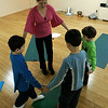 Salem: Marsha Danzig, an amputee, with her yoga students at Green Tea Yoga in Salem. The yoga instructor runs a program called Color Me Yoga with an emphasis on reaching children who have physical, emotional or mental challenges. Photo by Mark Lorenz/Salem News